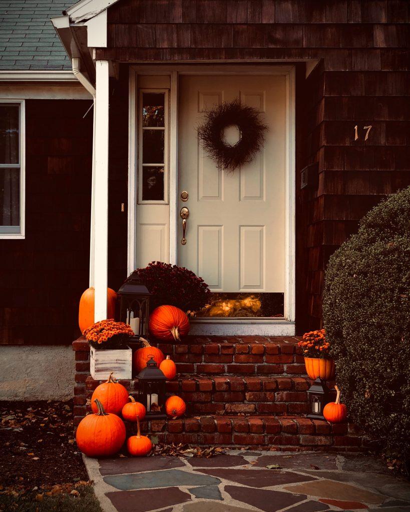 Pumpkins outside door for Halloween
